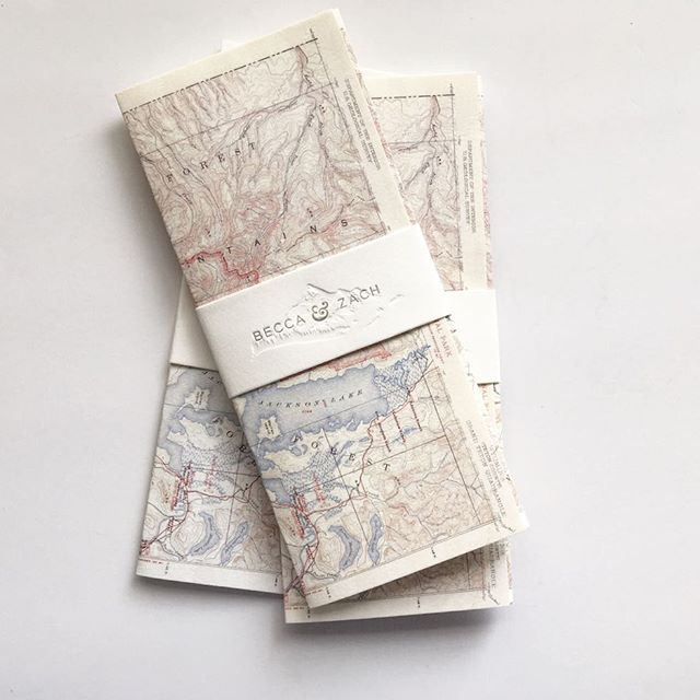 Remember those beautiful blind emboss mountain wedding invitations? Here's another sneak peek at the final product- we packaged everything in a vintage map of the Grand Teton National Park, enclosed with a blind deboss + letterpress belly band. #swellpressweddings