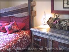 Antique barn wood in second bedroom reflects Old World charm in this exquisite condo in Canmore. #vacation #travel #spring #springbreak #alberta
