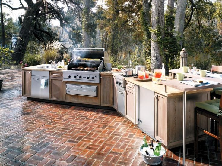 Backyard Mediterranean Outdoor Kitchen Decoration Ideas On Alternating Patterned Deck Feats Sectional Island Backyard with an Outdoor Kitchen Mediterranean Style for Modern House