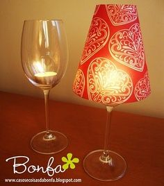 #DIY Wine Glass Lanterns. Combine #scrapbook paper and #battery powered tea -lights for the perfect look for any room in your #home.