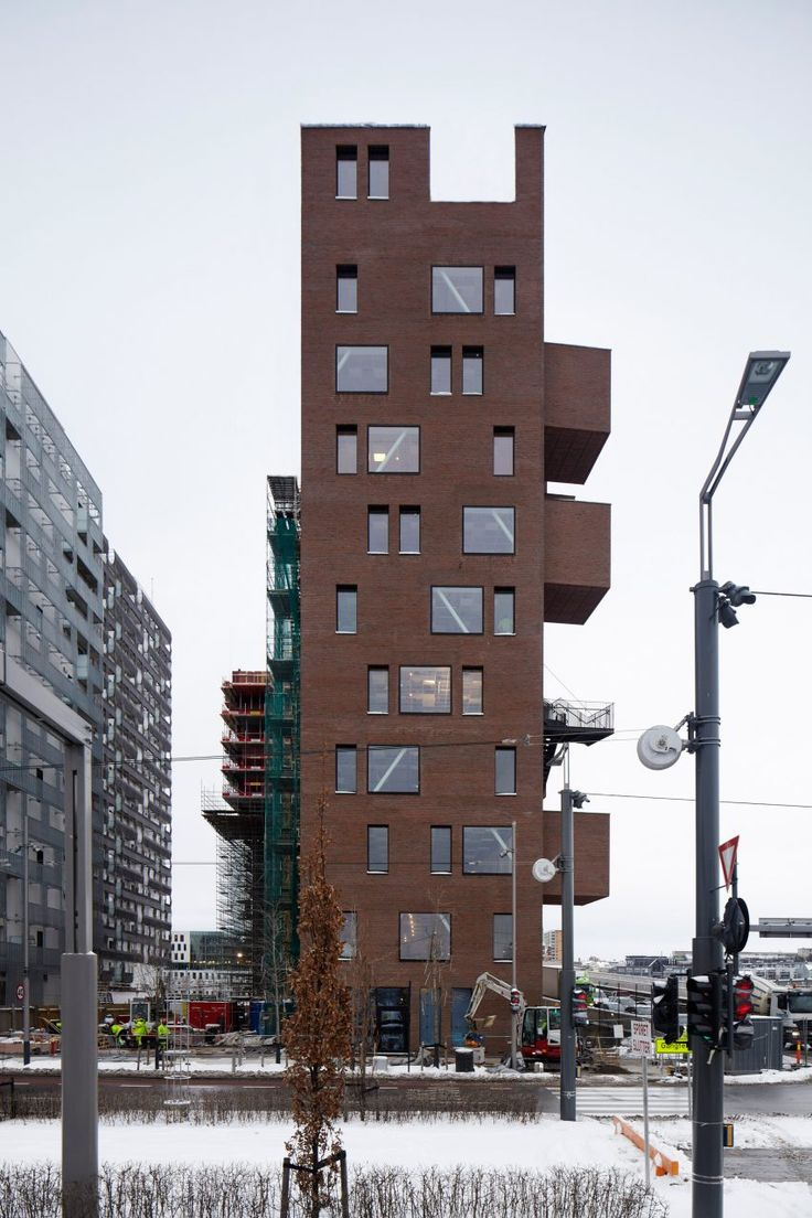 Red-brick boxes pop out of A-Lab's narrow office block on Oslo waterfront