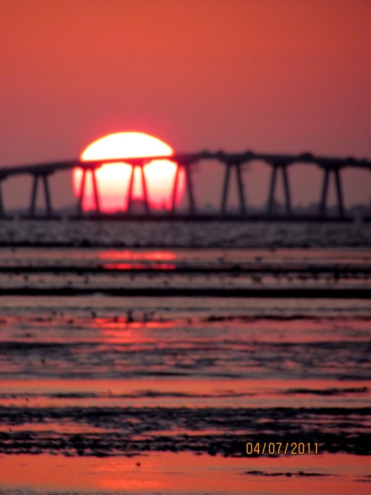 Sun behind Sanibel Causeway, Fl