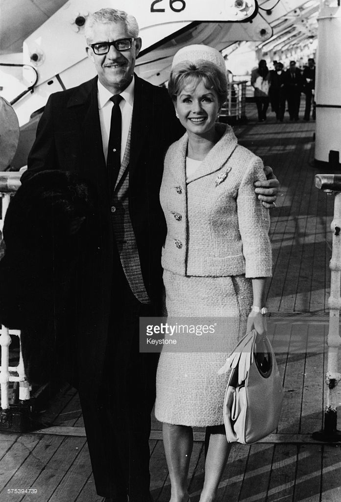 Actress Debbie Reynolds and her husband Harry Karl pictured aboard the Queen Elizabeth liner as they arrive at Southampton, October 13th 1964.