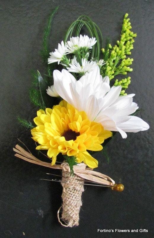 Boutonniere with daisies, viking pomp, raffia, solidago ...
