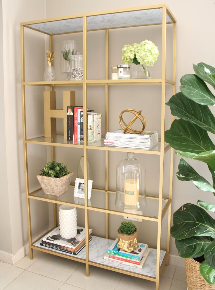 Ikea VITTSJÖ shelving unit transformed into a glorious gold book shelf. See how at www.houseofhawkes.net