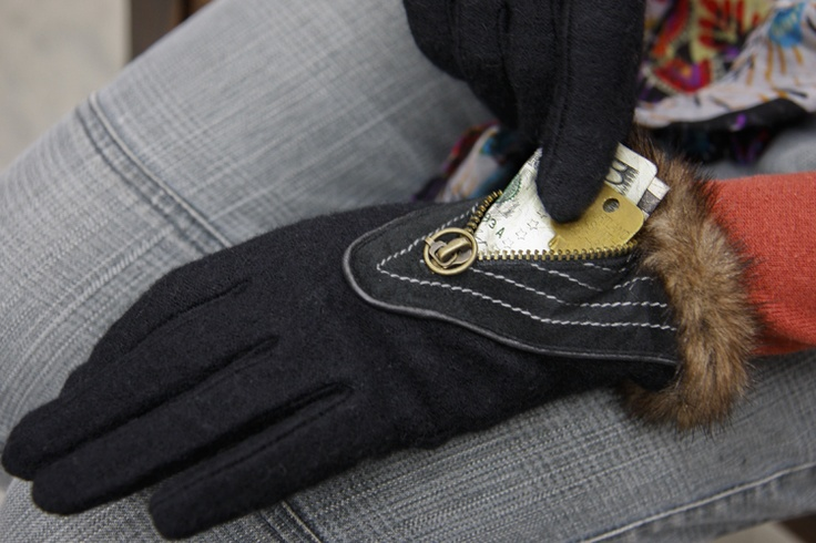 the St. Petersburg Gloves with pockets in action. They're only the size of the triangular stitched area around the zipper, but you can fit a few bills, a key, matchbook, bus ticket, or other small essentials!
