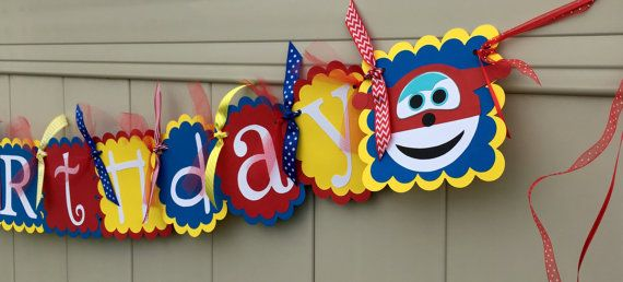 Is your son or daughter love Super wings on Sprout? Are you having a Suoer Wings birthday party? This cute party banner will be the perfect