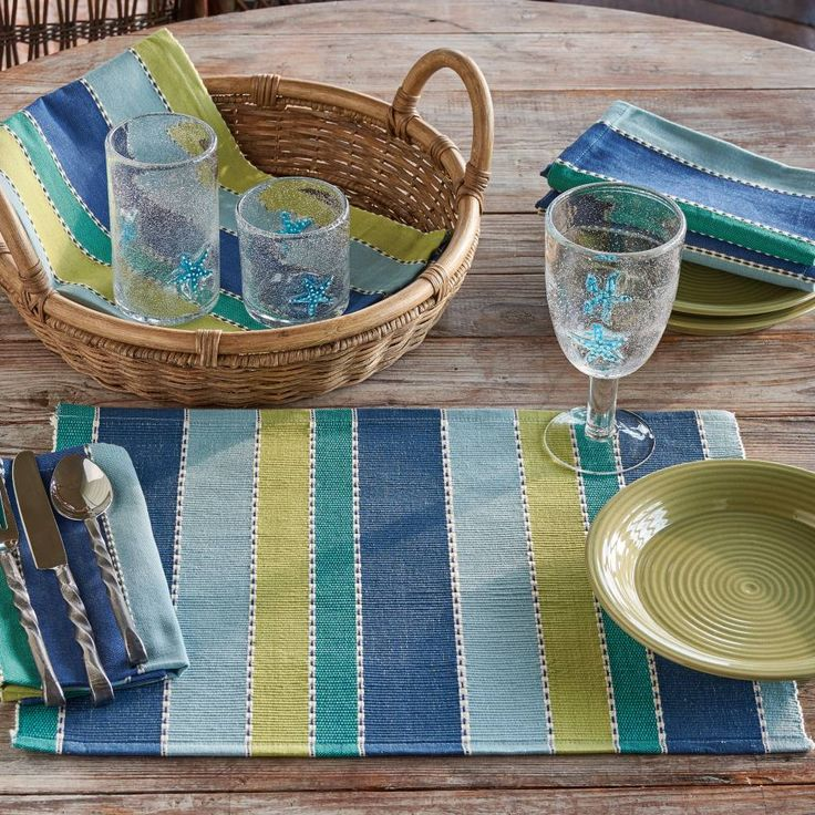 Escape to a place of quiet reflection, be inspired by the beautiful and exotic, and enjoy the serenity of the tropics. Now so easy to add this ambiance to your home with our Indigo Collection by Park Designs. Bold stripes of aqua, light avocado, and tones of blue add versatility, coordinating with solid or striped placemats. #country #kitchen #tablesetting #placemat #summer