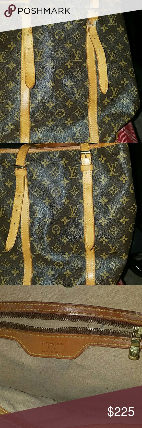 Beautiful AUTHENTIC LOUIS VUITTON BUCKET BAG This bag is used has signs of wear, I refurbish the lining after I got it meaning ,I pulled out all the sticky peeling lining. One of the straps are damage but it was that way when I got it.  But it still is a great bag its just too big for me. More pics on  my page!!!!.  You can purchase it on the other post Louis Vuitton Bags Shoulder Bags