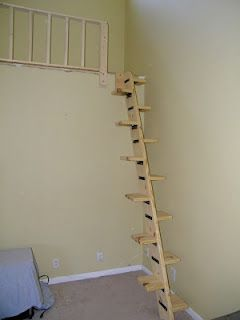 create a loft space in the vaulted ceiling area above the stairs with retractable ladder to