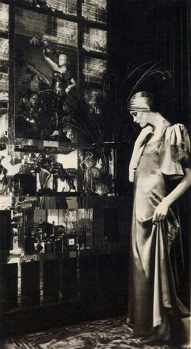 """Biba (1960s London rediscovers 1920s-30s) Original Kensington boutique started by Barbara Hulanicki (w/ copies of B. Bardot dress) Popular mid 60s-70s.Biba'selongated vintage-inspr'd """"look""""-cloches turbans trailing scarves fitted puffcap + bell slv's dk berry colors-Kensington store was its own world - """"must"""" for bright young things of late 60s London... (Label recently revived by new company...)"""