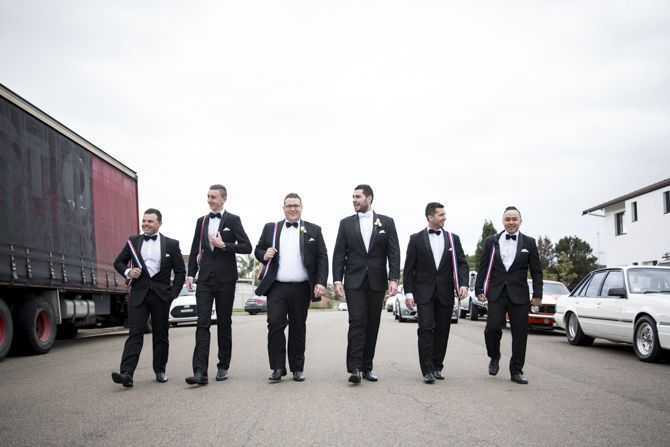 A truck parked on the side of a suburban street in Sydney added a cool industrial vibe for this groomsmen shot #sydneywedding #sydneyweddingphotographer #weddingphotographer #groomsmen #suits #groom #bridalparty