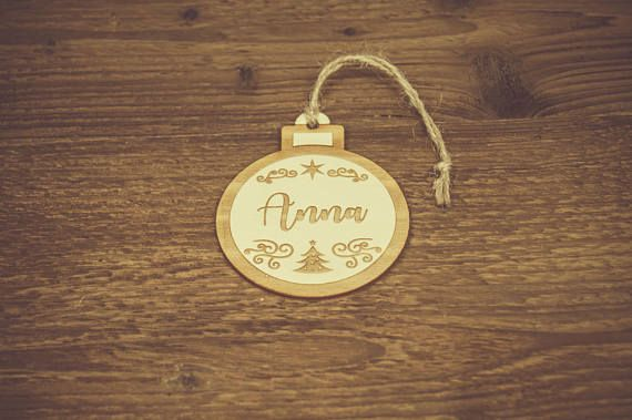 Personalized Christmas Tree Ornaments, Decorations made of plywood.  Each piece is made of natural materials so it may slightly vary from each other.  Please write the name/names when placing the order.  Dimensions: 3x3.7 inch (76x95 mm)   Please feel free to ask us any questions.  ESTIMATED SHIPPING TIME: Please read carefully the shop policies. If you order soon before the Christmas we can arrange an express shipment at additional cost.