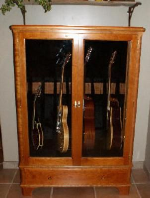 Guitar Cabinet? I like the idea. Nice for storing the entire family's guitars.
