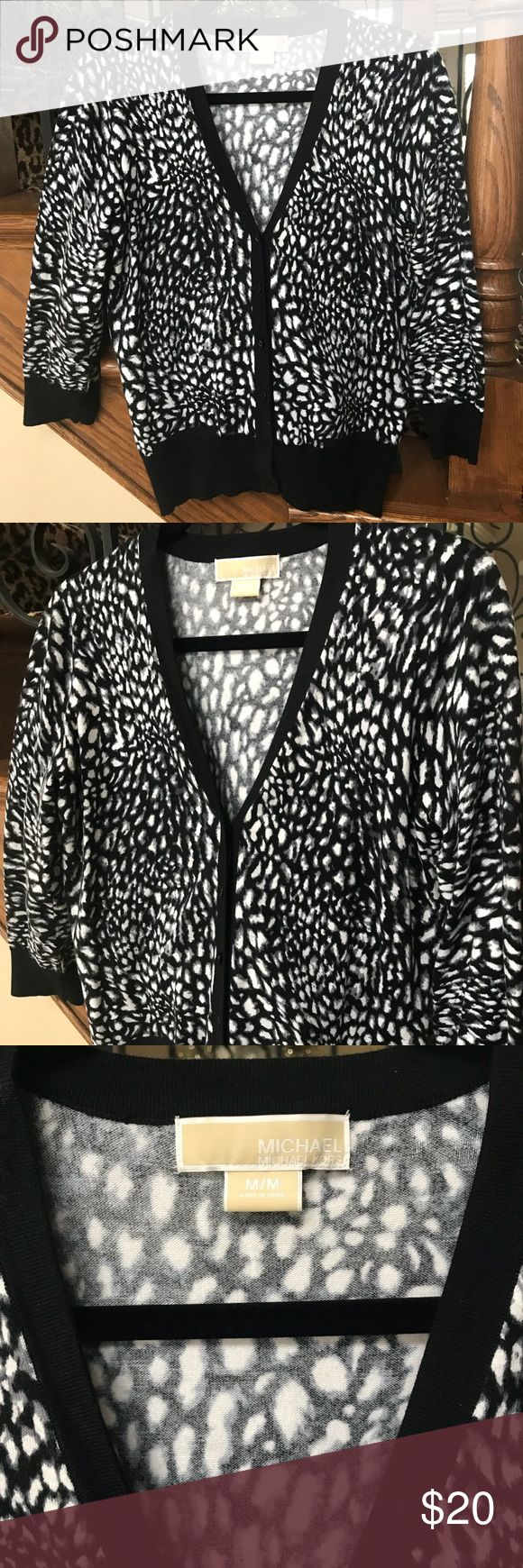 Black and white Michael Kors cardigan. Size M Black/white/gray animal print cardigan sweater. 3/4 sleeves. MK button closure. Little hidden front pockets. Super cute over a LBD!!  Like new. MICHAEL Michael Kors Sweaters Cardigans