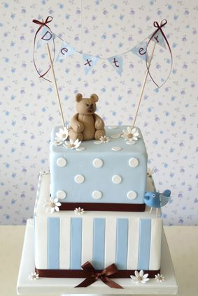 Polka dots and stripes teddy bear cake with bunting - could incorporate a cross somewhere for the christening :)