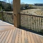 Custom deck  with Fiberon composite  decking  with Herring-Bone Picture Frame design  with Fortress Panel Railing. High Point Deck post lighting.