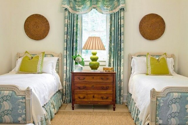 Blue and white twin bedroom with punch of chartreuse