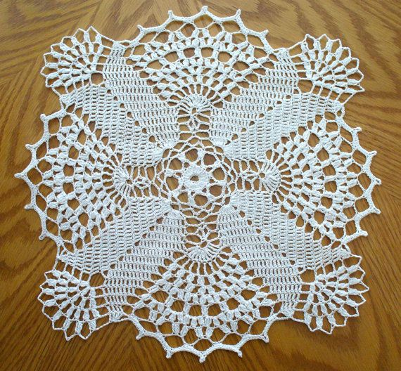 This beautiful handmade doily is made from white cotton thread, size 10. This elegant doily will look beautiful on any table or can be used for any other decorative purpose. It will also make a great gift for someone special. I can make this doily in any custom color, please send me a message if interested in your very own custom color doily. Width = 13.5 in. Height = 13.5 in. Care instructions: It can be hand washed in lukewarm water, lay down flat to dry, spray with starch when...