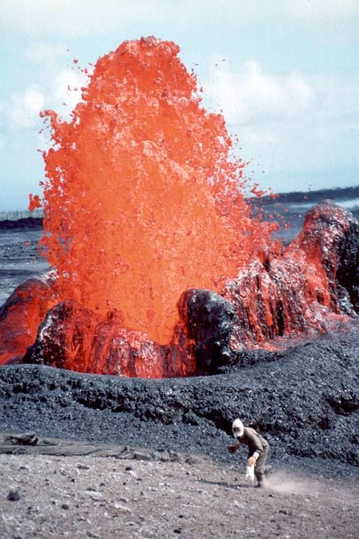 1993 eruption of Kilauea Volcano, Hawaii. A geologist is collecting spatter samples.