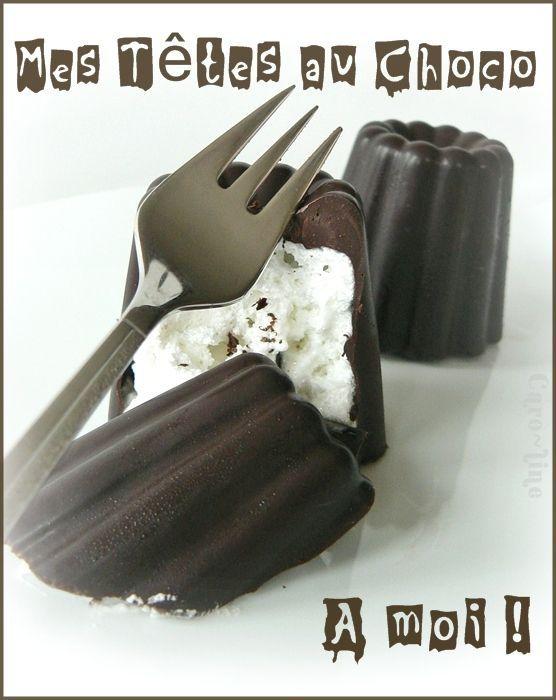 Tête de Nègre   -     6 TETES au CHOCO  Pour les coques 200 g de chocolat noir Suisse  Pour la garniture (meringue italienne) 100 g de blancs d'oeufs 180 g de sucre semoule 50 g d'eau    6 gaufrettes rondes (du même diamètre que les moules en silicone)