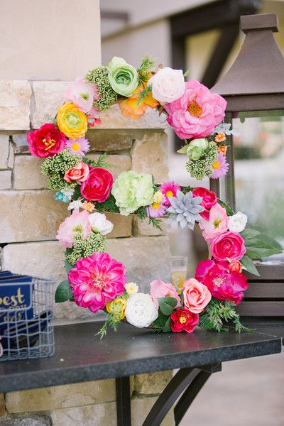 Wedding monogram idea - fun and colorful wedding decor - the couple's last initial was covered in bright flowers {Monica Roberts Photography}