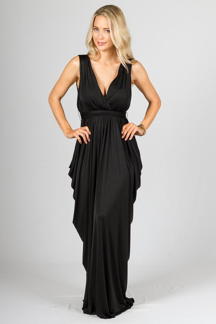 """Aphrodite Maxi Dress - Black - Paper Scissors Frock. A stunning grecian inspired maxi dress. Deep V-neck, heavy draped sides, pin tuck feature on shoulders and elasticised waist with matching fabric sash belt.  Made from high quality stretch jersey.   *This dress was shot wearing flat sandals not heels.  Pictured Model 5'8""""."""