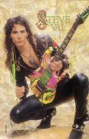 "One of my all time favorite pics of Steve! The guitar is a 7-string Ibanez Universe. Steve invented the 7 string guitar. This one is extremely rare because it has the ""monkey grip"" feature commonly found on 6-string Jems."