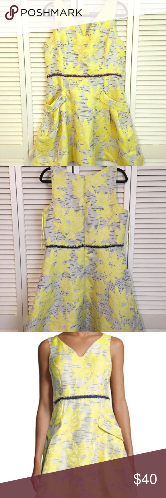 """Donna Ricco Sleeveless Floral Jacquard Dress Donna Ricco Sleeveless Floral Jacquard Dress in Yellow Pattern. Approx: 36""""L from shoulder to hem. V neckline, fringed band at waist, slide slip pockets, A line silhouette, back zip, cotton/spandex, machine wash. I'm bummed the pictures crop to square but if you google this Dress images do show up in full. It really is a fun and lovely dress to have for a wedding or special occasion. Donna Ricco Dresses Mini"""