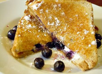 A breakfast twist on the classic grilled cheese that combines blueberries, cream cheese, and powdered sugar.
