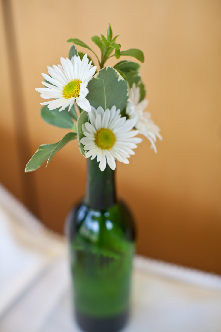 9 best images about flowers wedding ideas on pinterest for Wine bottle vase ideas