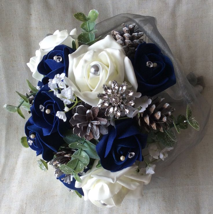 Winter poly foam bouquet with silver jewellery by Cathey's flowers
