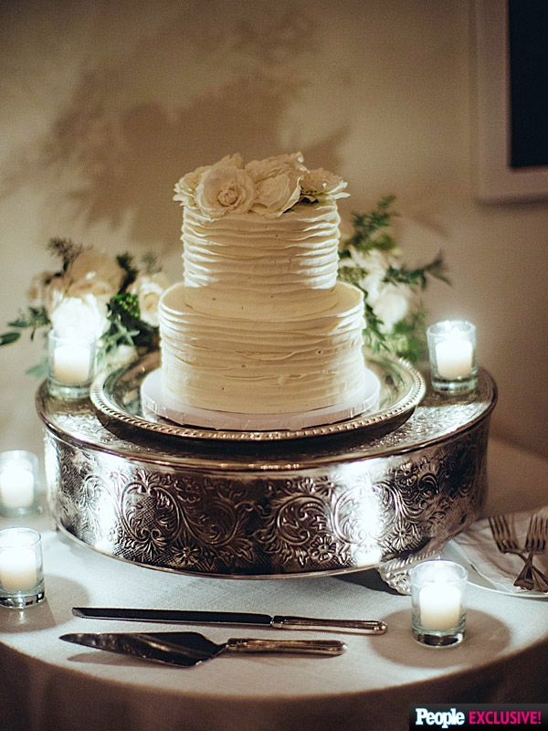 Beneath the swirling white frosting of their chic, understated two-tier confection, were layers of chocolate and vanilla cake.