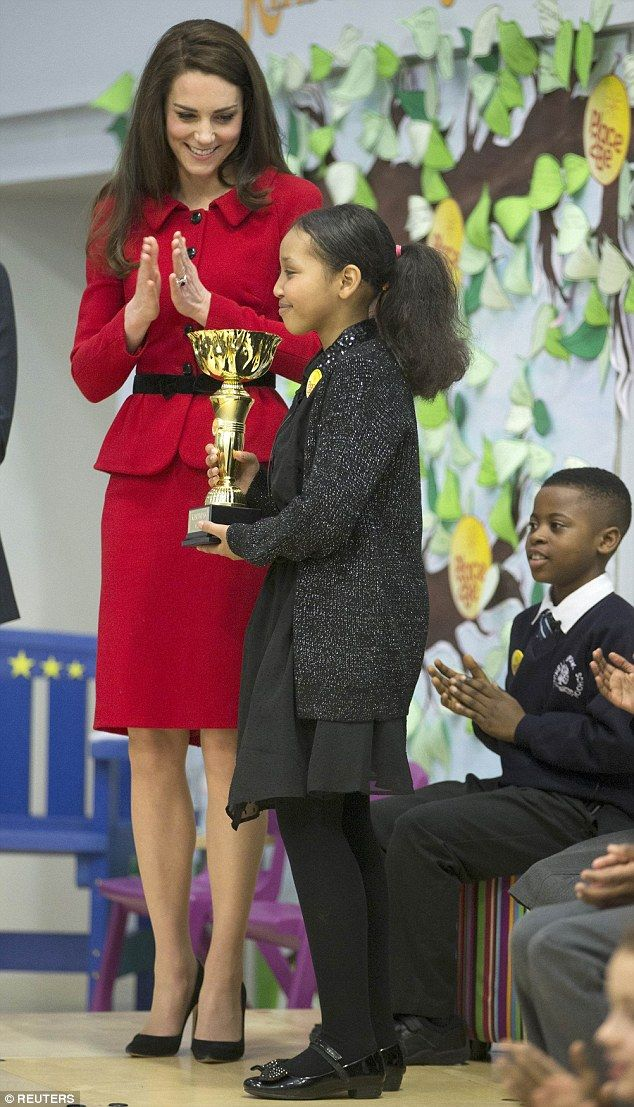 The Duchess of Cambridge presented a pupil with the school's first ever kindness cup...