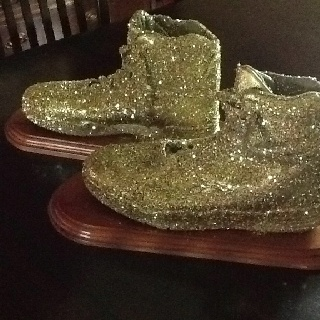 """""""The Golden Sneaker"""" award. I use this in my k-4 physical education to reward classes following the """"golden rule"""". The award is given out monthly at our school assembly. To make the trophy, I simply used my husbands old basketball sneakers and had a friend mount them on a trophy base. I then spray painted them gold and to add sparkle, used spray adhesive to add gold glitter."""