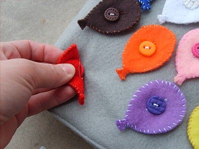 Create small felt shapes in many colors, and a neutral felt mat. For each shape, create a buttonhole, and sew a matching colored button to the mat- this is an easy and inexpensive activity that works on buttoning skills as well as color and shape matching!