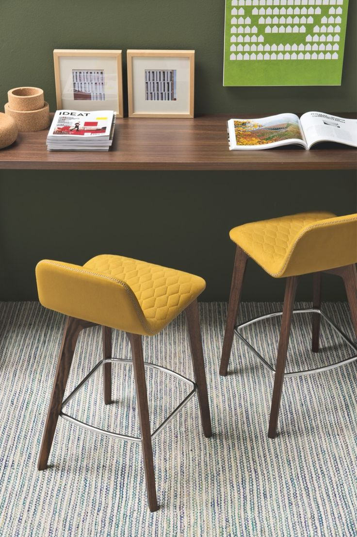 Classic with a twist, the SAMI stool perfectly combines the sturdiness of solid wood and the softness of upholstered fabric. The fabric cover, made of pure cotton with stain-resistant and anti-bacterial treatment, is available in many different bright colours, which can be matched with all of the finishes of the wooden base, fitted with an elegant metal footrest. #calligaris #toronto #modern #stool