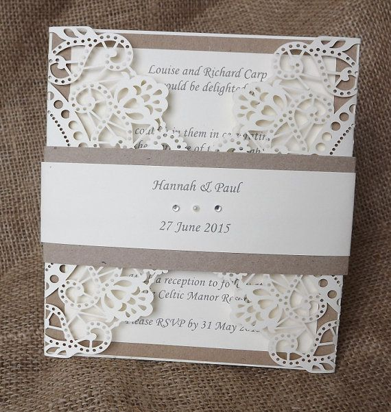 Rustic laser cut wedding invitation by CardiffInvitations on Etsy, £3.95 .  Like the belly band