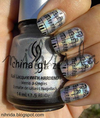 AWESOME. To get this, simply paint your nails a colour of your choosing, and then dip into a liquid containing alcohol. Vodka, tequila, anything. Shake off any excess, then press a music score against the nail for a few seconds. Et voila! Musical nails! :)