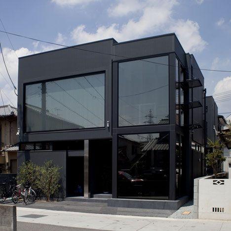 Long, narrow windows cut across the sides of a house in Okayama, Japan,