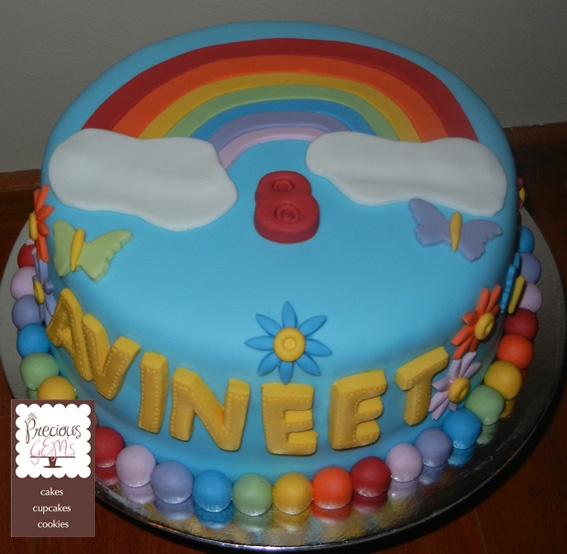 A rainbow party requires a bright coloured cake. This Eggless Chocolate Cake is beautifully decorated with fondant icing.