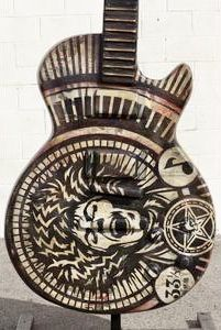 """Here is American Artist Shepard Fairey's, """"Electric Warrior"""", one of the 10-foot tall Gibson guitar art sculptures exhibited in the Gibson GuitarTown public art project in 2013. The painted guitar was inspired by Marc Bolan of T-Rex.  """"I was excited to contribute to this project because I love the intersection of art and music"""", said Fairey. Since it is a Gibson guitar project I created a piece inspired by Marc Bolan of T-Rex who played a Gibson."""