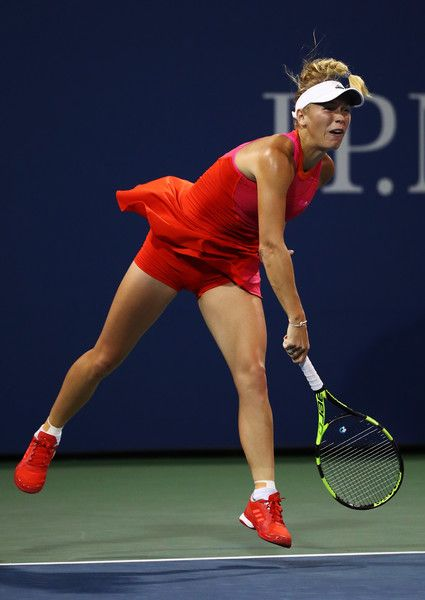Caroline Wozniacki of Denmark serves against Ekaterina Makarova of Russia during their second round Women's Singles match on Day Three of the 2017 US Open at the USTA Billie Jean King National Tennis Center on August 30, 2017 in the Flushing neighborhood of the Queens borough of New York City