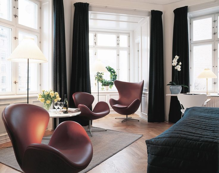 Elegant Scandinavian Living Room Design With Brown Leather Arne Jacobsen Swan Chairs And Egg Chair On Bay Window With Black Curtain Designer Chairs Swan Eggs Bringing Elegant Past Retro Styles Modern Interior Decorating