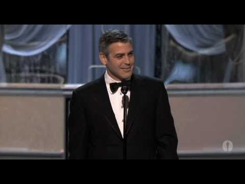 George Clooney accepts his best supporting actor Oscar for Syriana via YouTube.
