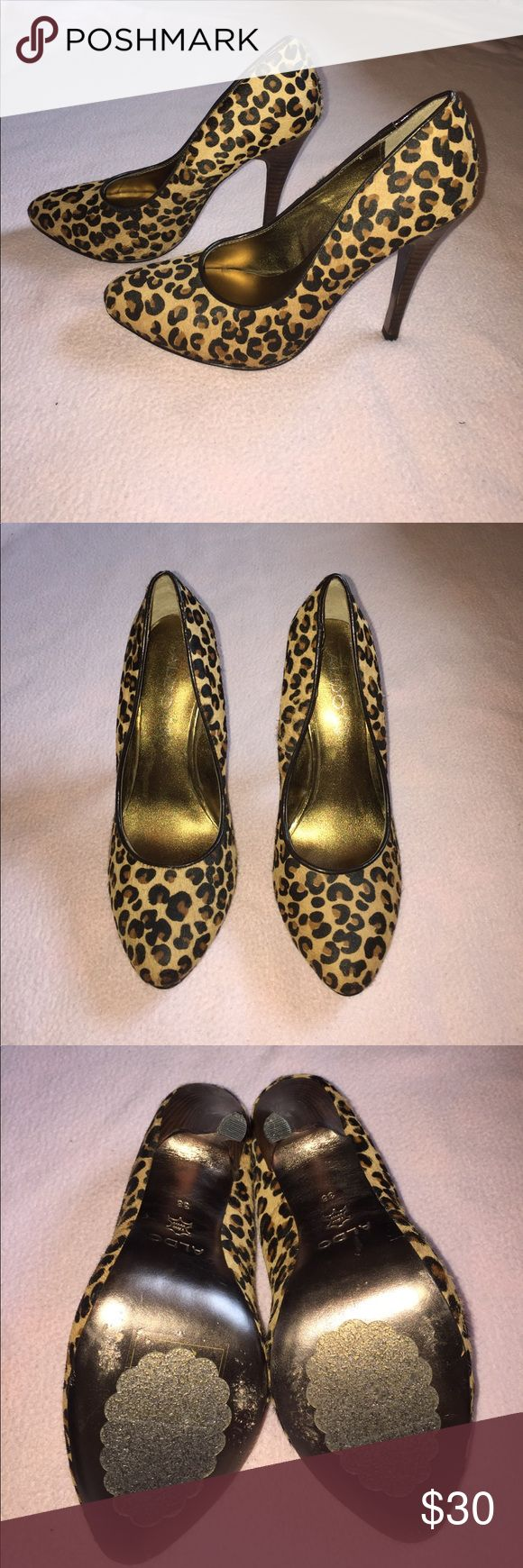 Aldo Leopard Pumps Sassy, fun, and cute, leopard print pumps! Can dress them up with a dress or more casual with a chambray button down! Gently used. Some of the little hairs on the shoes stick up, but they were like that when I got them. They are in good condition. Aldo Shoes Heels