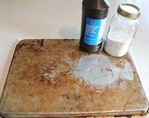 Use hydrogen peroxide and baking soda to clean your old cookie sheets. NO scrubbing!