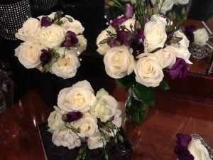 white roses and purple lisianthus bridesmaid bouquets