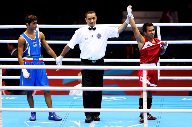 http://www.MilitaryGradeNutritionals.com/blog  LONDON, ENGLAND - JULY 31: Mark Barriga of Philippines (R) celebrates his victory over Manuel Cappai of Italy during the Men's Light Fly (46-49kg) Boxing on Day 4 of the London 2012 Olympic Games at ExCeL on July 31, 2012 in London, England. (Photo by Scott Heavey/Getty Images)