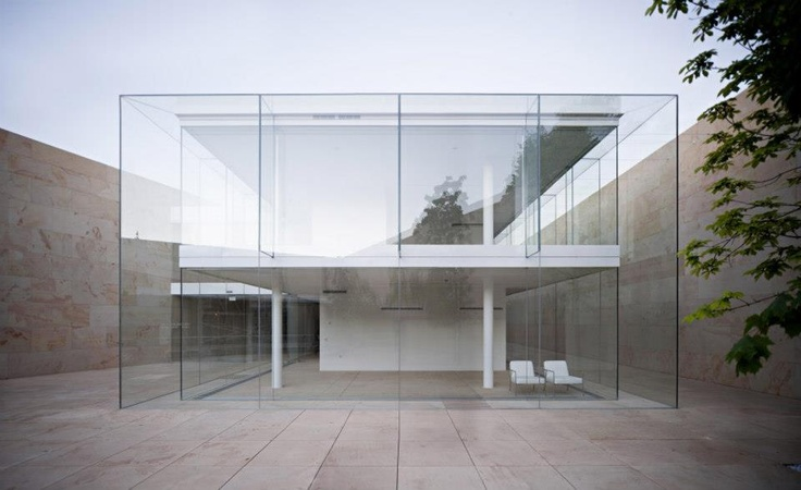 glass structure in concrete frame.